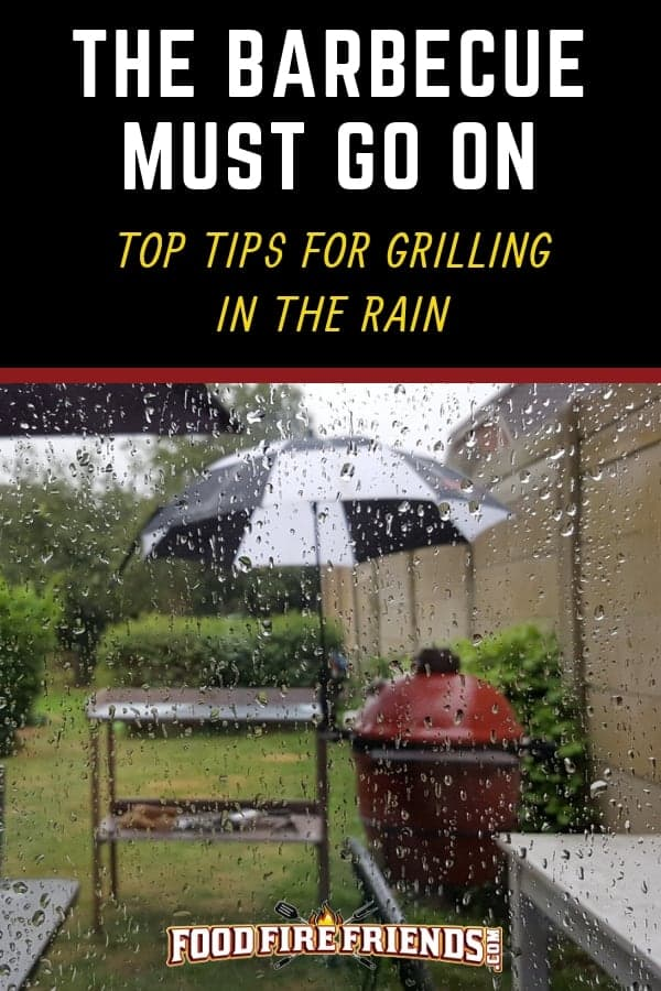 Photo of a kamado grill with an umbrella over it while grilling in the rain