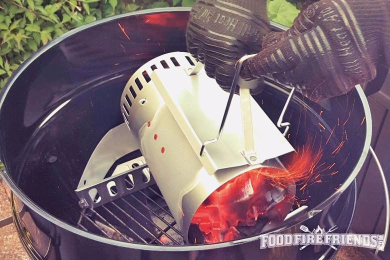 Using a charcoal chimney starter to fill a grill with coals
