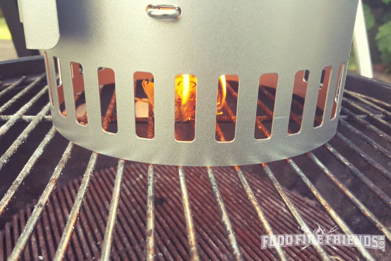 Lighting the charcoal chimney starter with wood wool