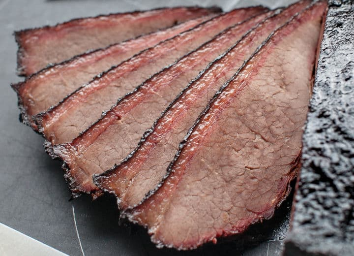 A smoke ring seen on slices of brisket