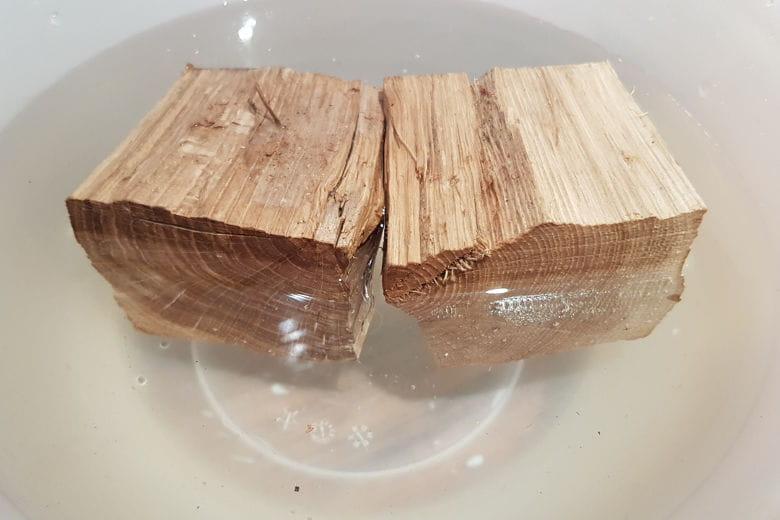 2 chunks of oak wood soaking in a bowl