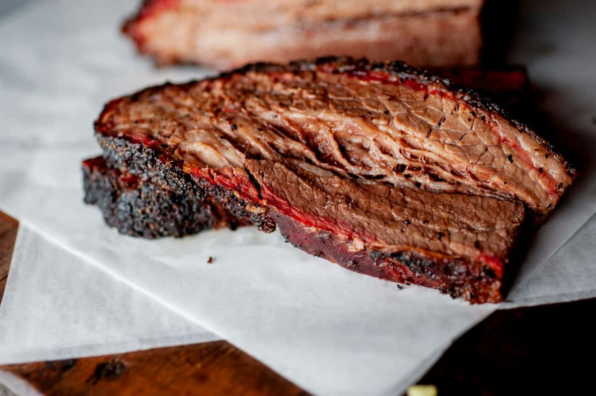 A slice of moist looking brisket with a fantastic smoke ring