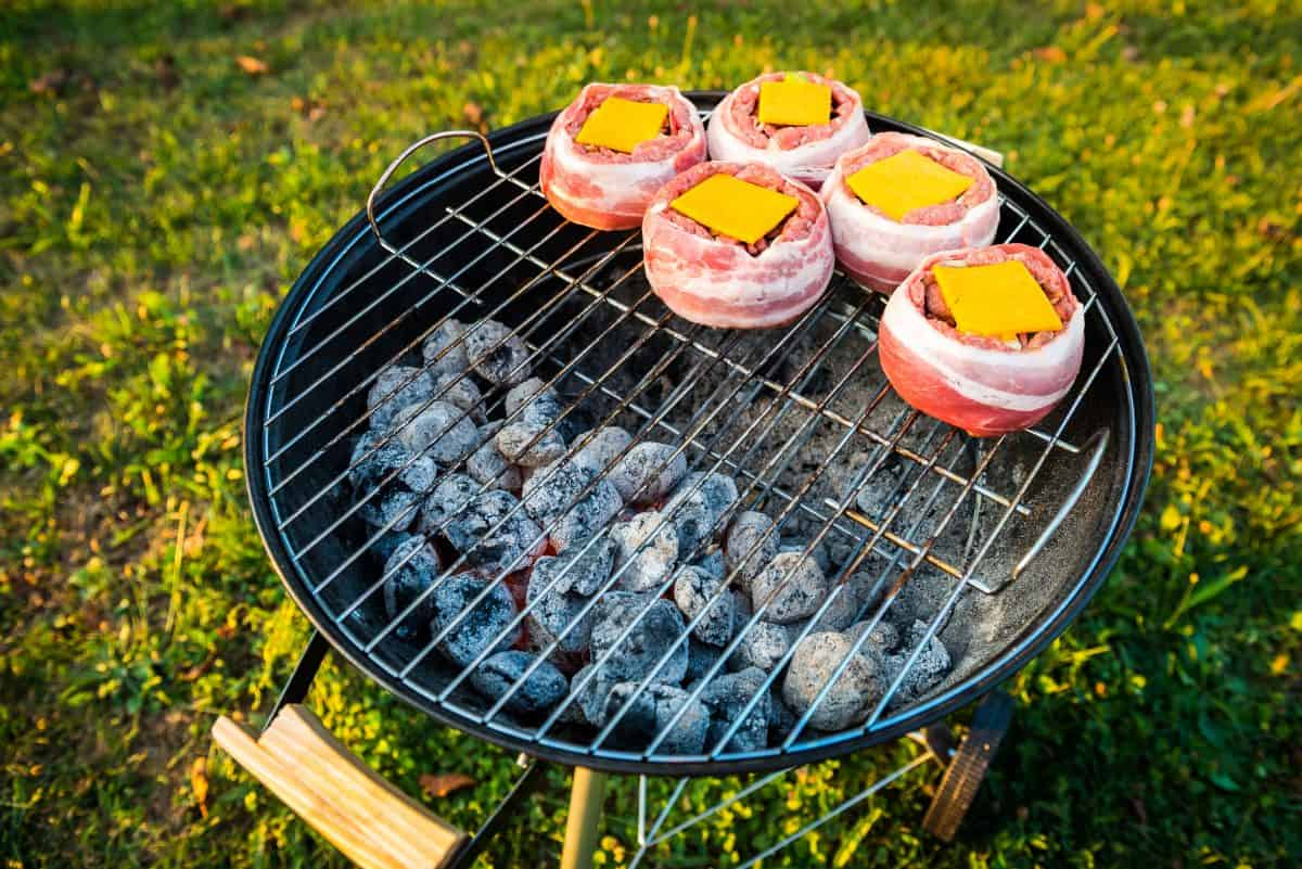 Bacon wrapped beer can burgers grilling indirect on a charcoal grill