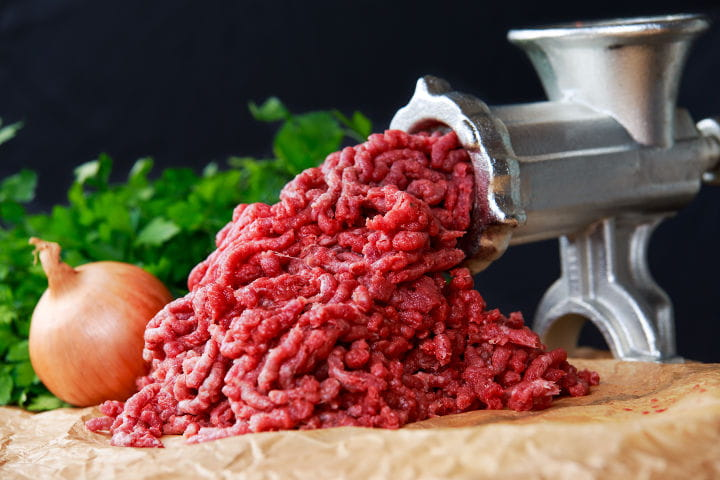 Beef being put through a mincer