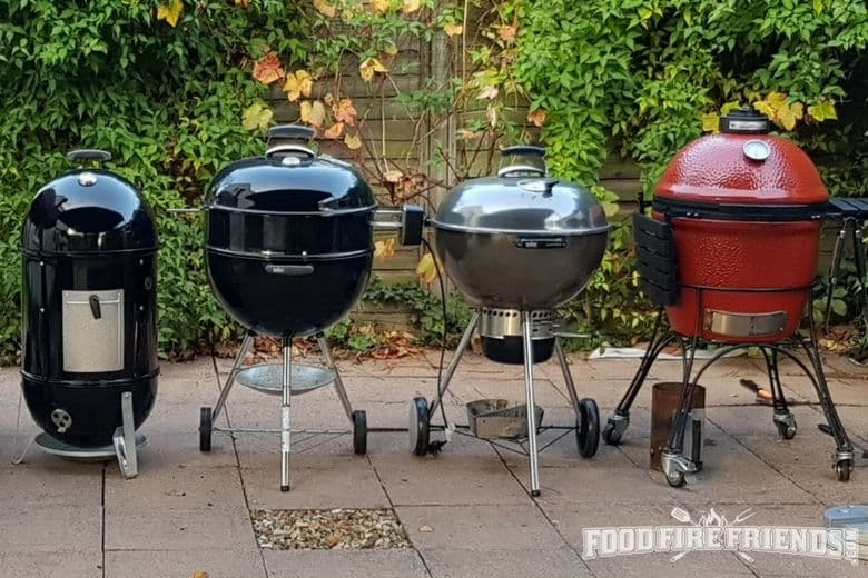 Wide shot of different types of smokers and grills