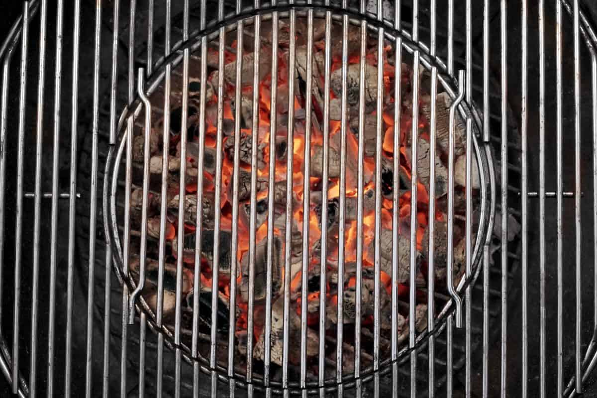 Stainless steel BBQ grates, wioth a round fire of coals beneath