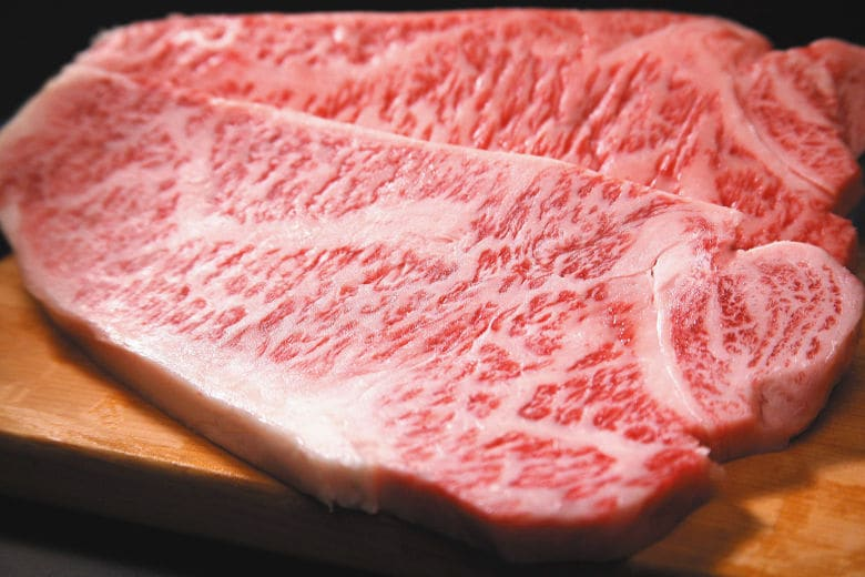 A close up from some highly marbled Wagyu beef