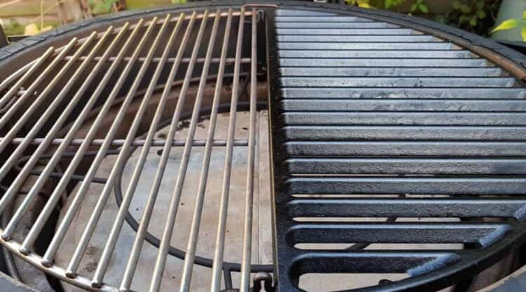 Close up of a half cast iron and half stainless steel grate installed into a Kamado Joe