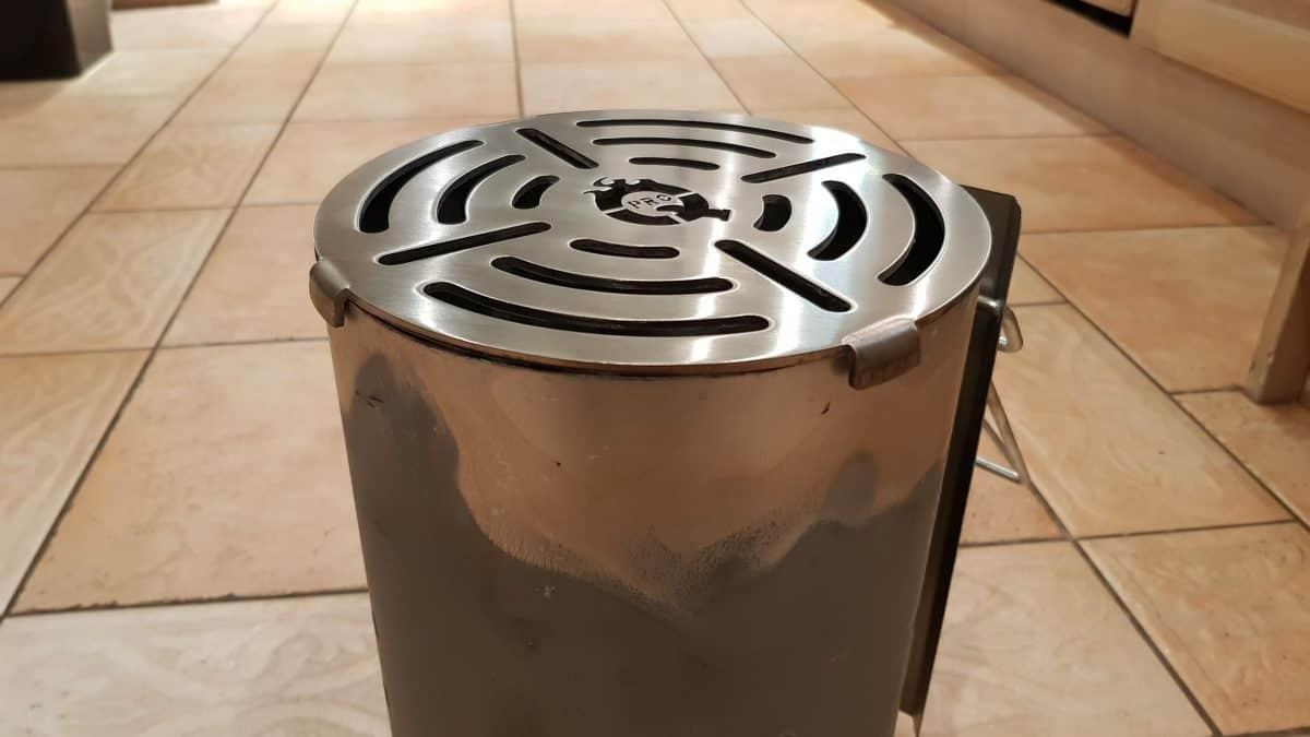 Aan afterburner charcoal chimney grate for searing steak, sitting on the starter