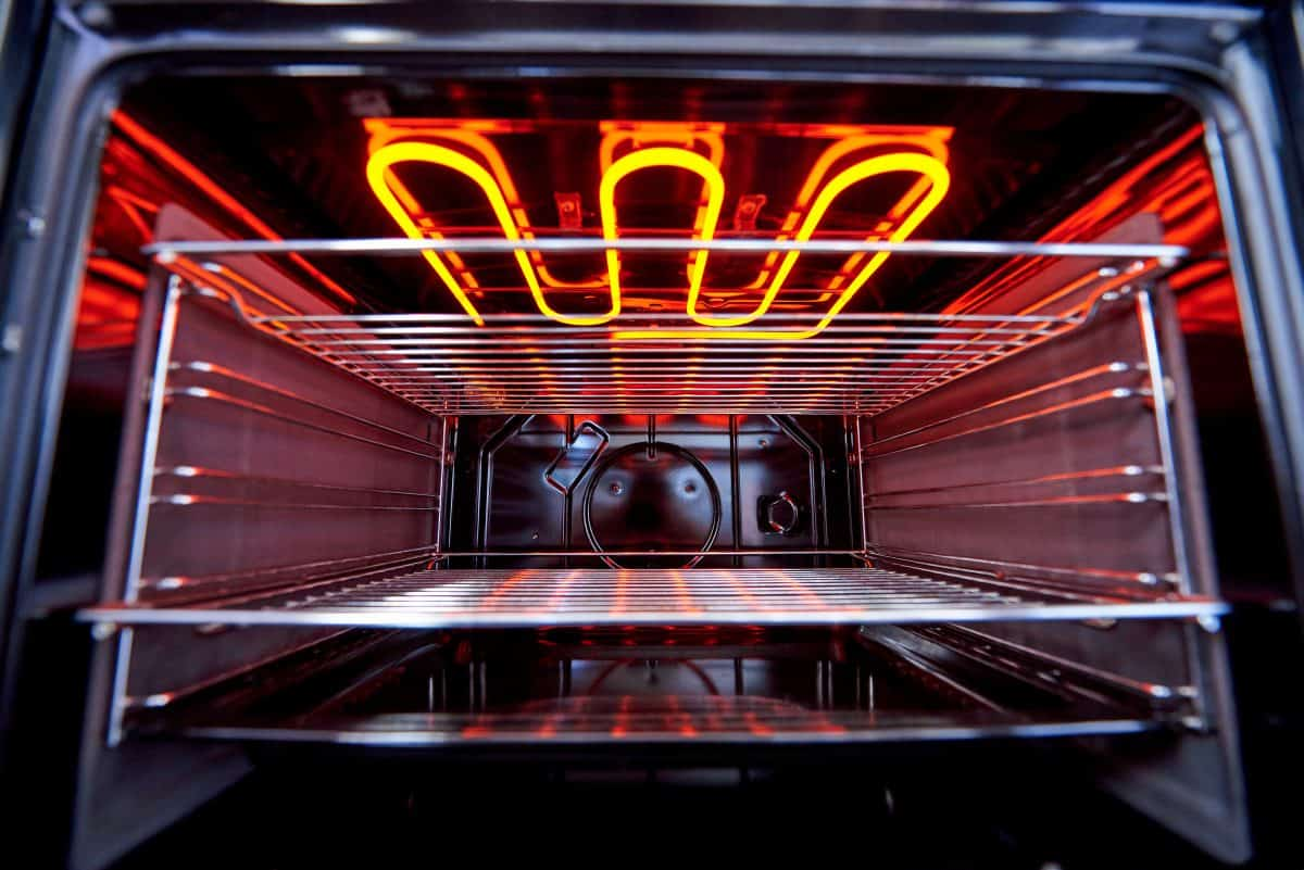 A glowing red hot, kitchen oven broiler seen from below