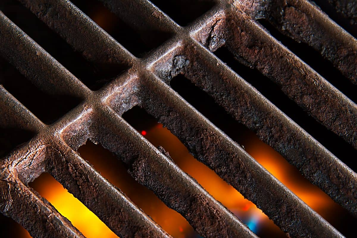 Close up of rusty cast iron grill grates