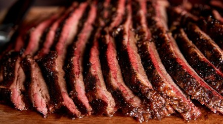 Moist looking sliced smoked brisket with a smoke ring