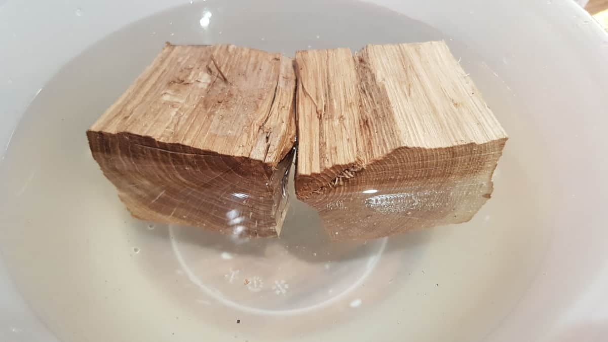 2 chunks of oak wood soaking in a bowl
