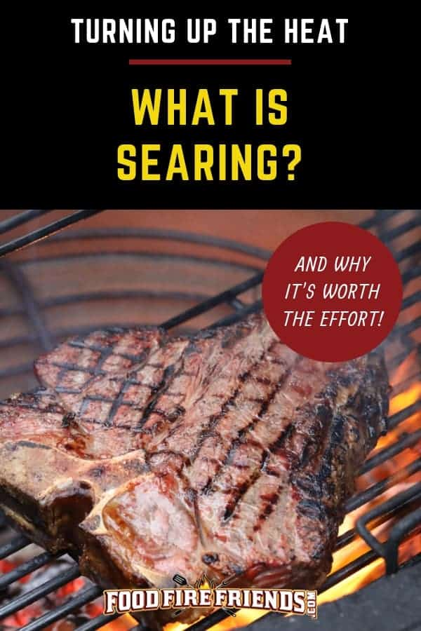 what is searing - written above a porterhouse steak being seared on a charcoal grill