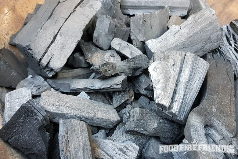 A firebox full of the best lump charcoal, ready for grilling