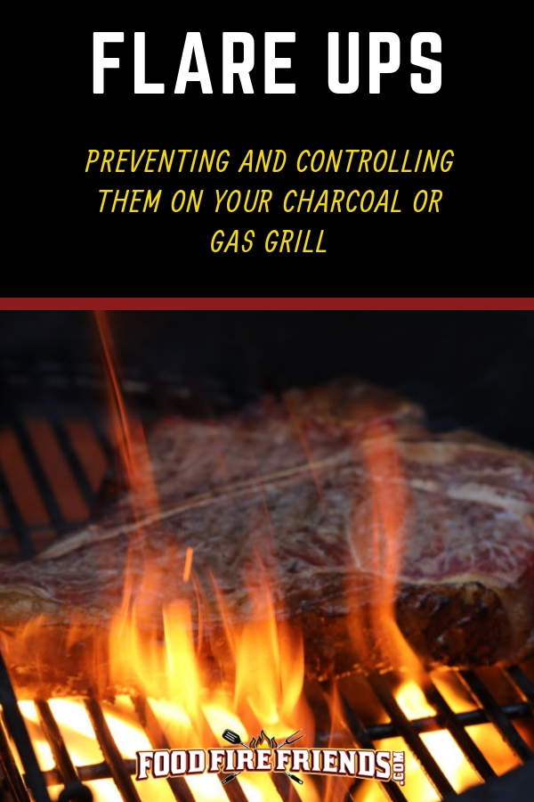 Photo of a flare up on a charcoal grill with a steak being grilled