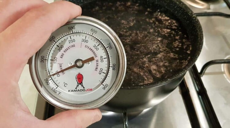 Kamado Joe dome thermometer being calibrated in boiling water