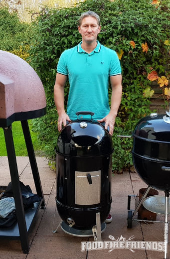 Me standing behind my Weber Smokey Mountain