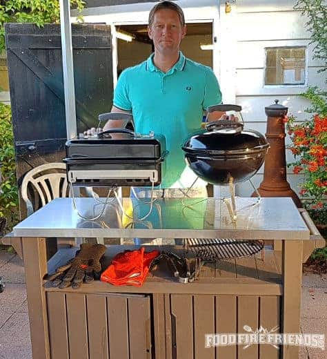 Me holding both my Weber travel BBQs: The Smokey Joe and the Go-Anywhere