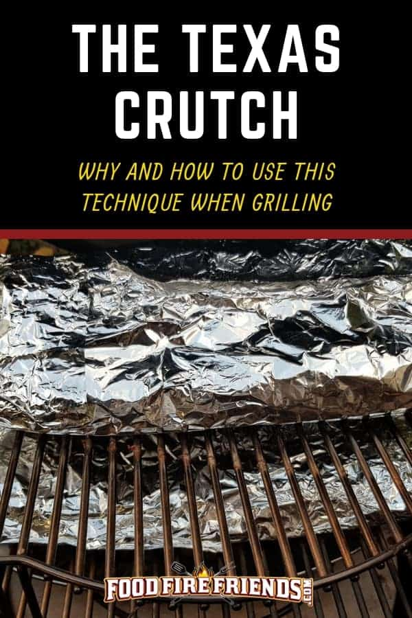 The Texas crutch - written across 2 aluminum wrapped joints of meat on a charcoal smoker