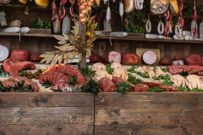 A selection of large joints of meat and sausages