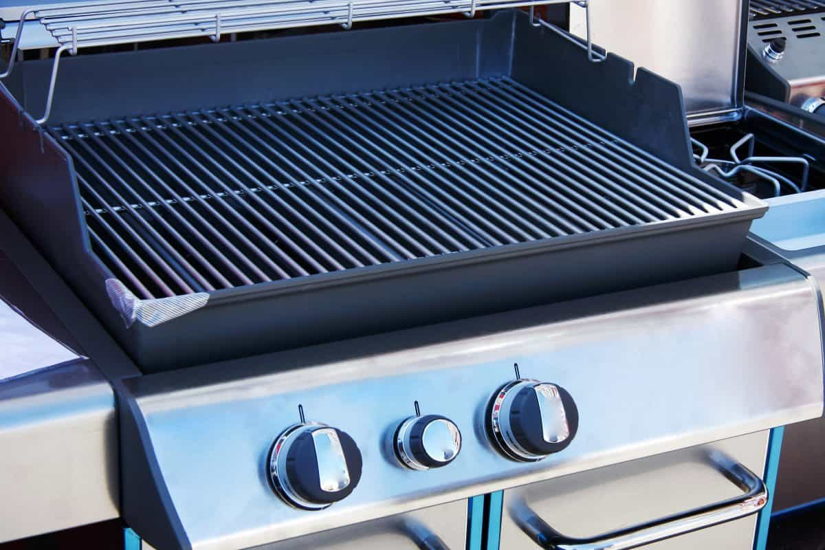 A brand new gas grill with lid open
