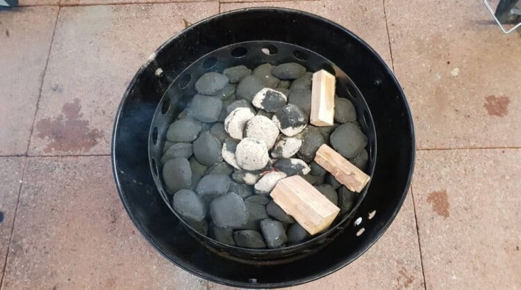 Overhead view of Minion method used in a weber smoky mountain