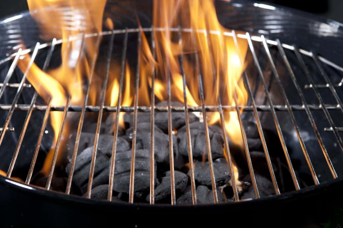 Burning briquettes in a brand new charcoal grill