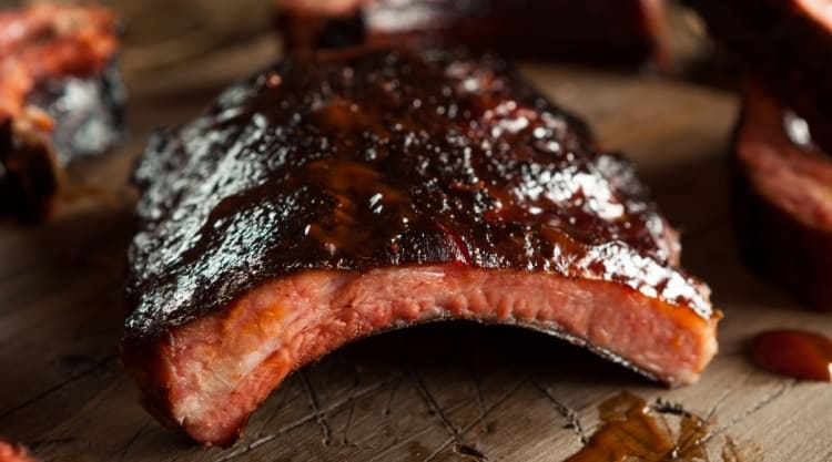 Close up of delicious looking, sticky sauce coated pork ribs