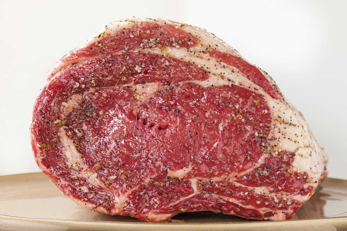 Side view of prime rib prepared for cooking