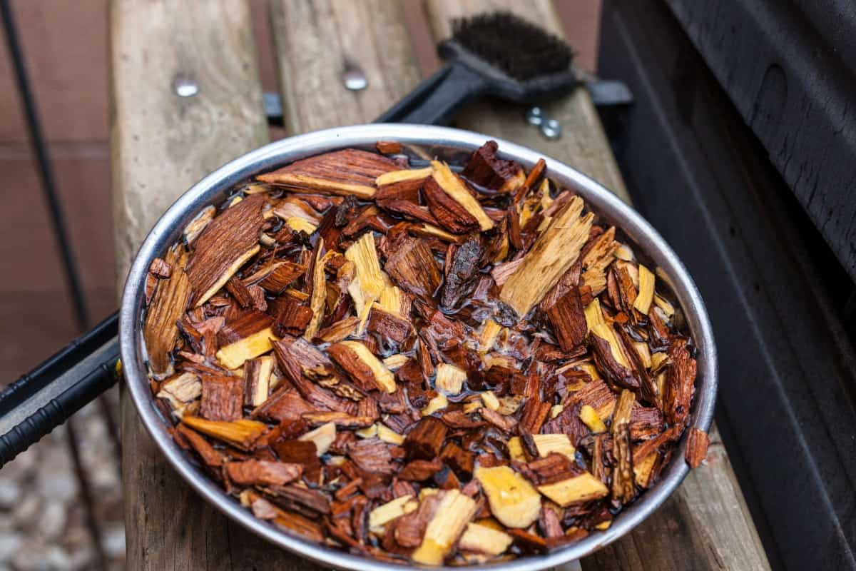 Mesquite wood chips being soaked in water before use for smoking