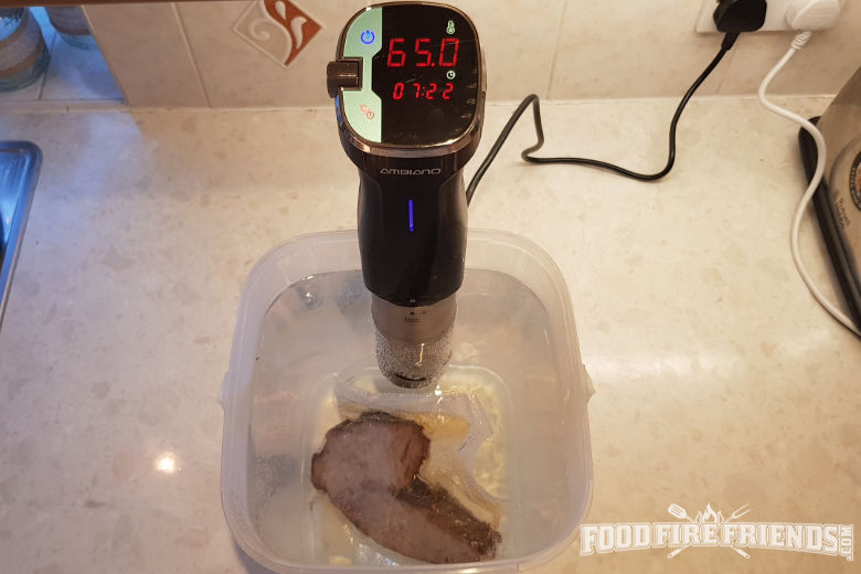 Brisket being reheated with the use of a sous vide wand