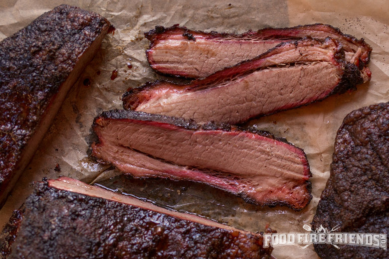 Some beautiful looking smoked, sliced brisket with a smoke ring visible