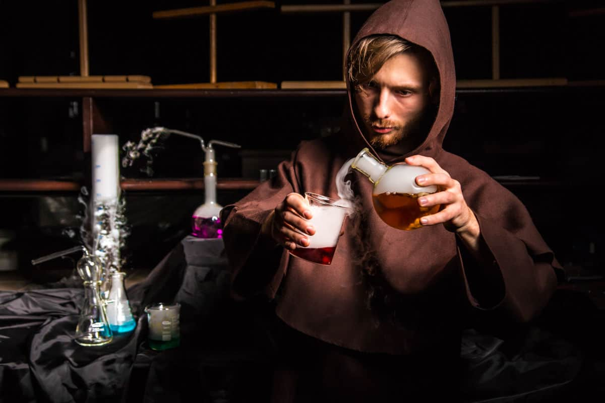 Mocked up image of fake liquid smoke being poured from a flask to a beaker by a chemist