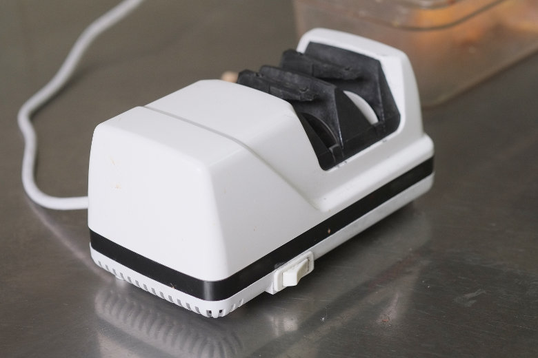 Close up of an electric knife sharpener on a kitchen worktop