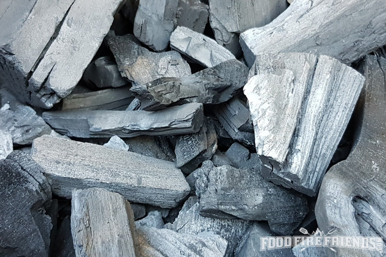 A close of lumpwood charcoal chunks