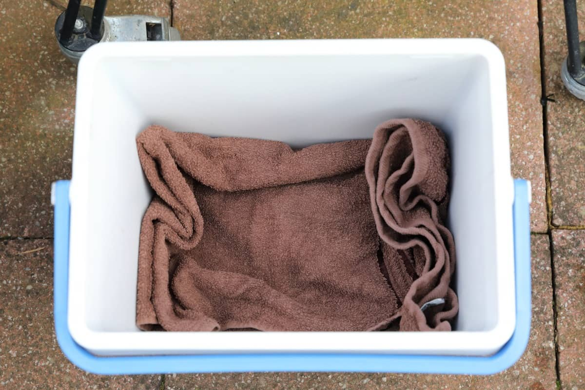 Overhead view of a towel in a blue and white cooler