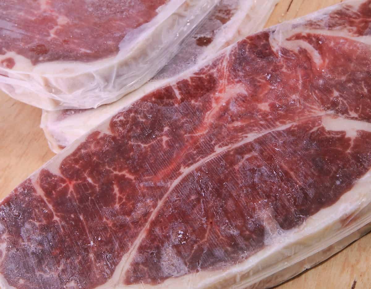 Close up of frozen strip steaks