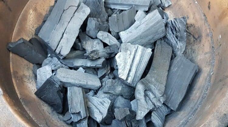 A close of lumpwood charcoal chunks