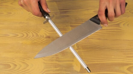 Photo of a demonstration on how to use a sharpening steel
