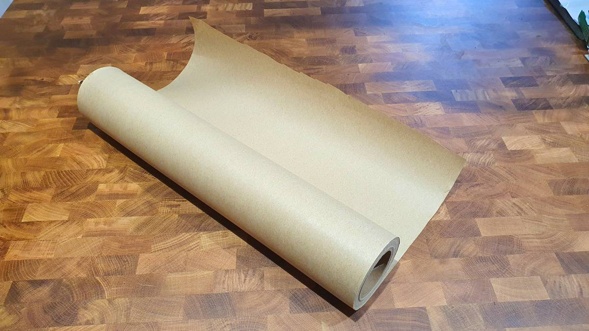 A roll of pink butcher paper on a wooden table