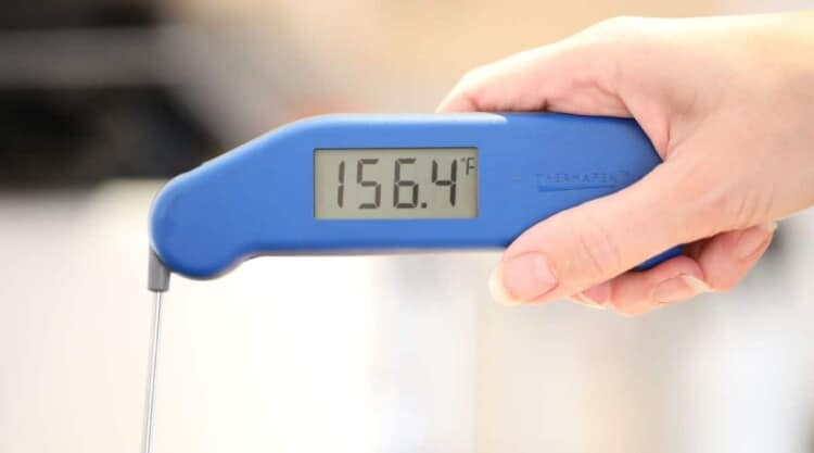 Instant read thermometer showing 156 F at the stall