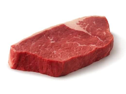 A raw bottom round steak isolated on white