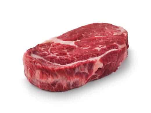 Raw chuck eye steak isolated on white