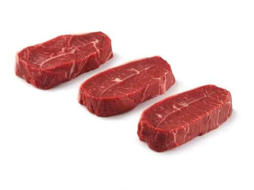 Three top blade steaks isolated on white
