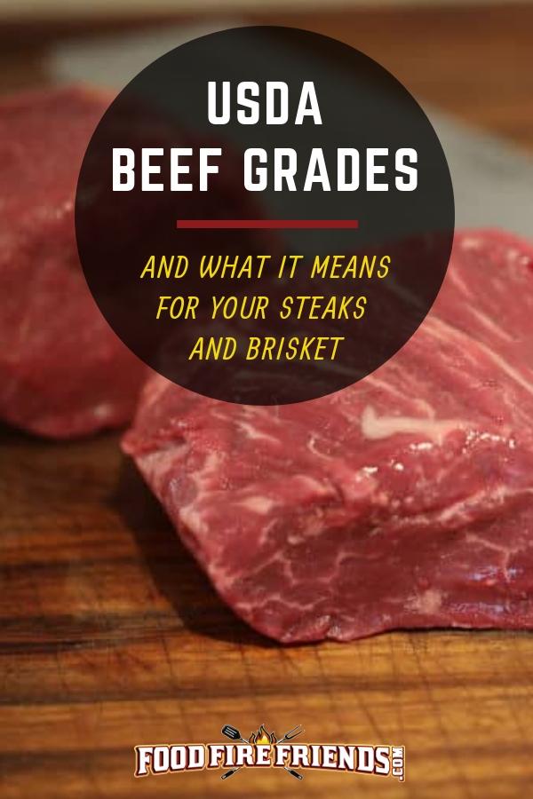 USDA beef grades written across two pieces of filet steak on a chopping board