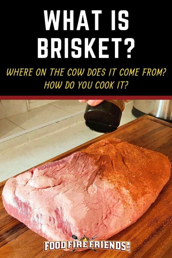A full packer beef brisket on a wooden chopping board