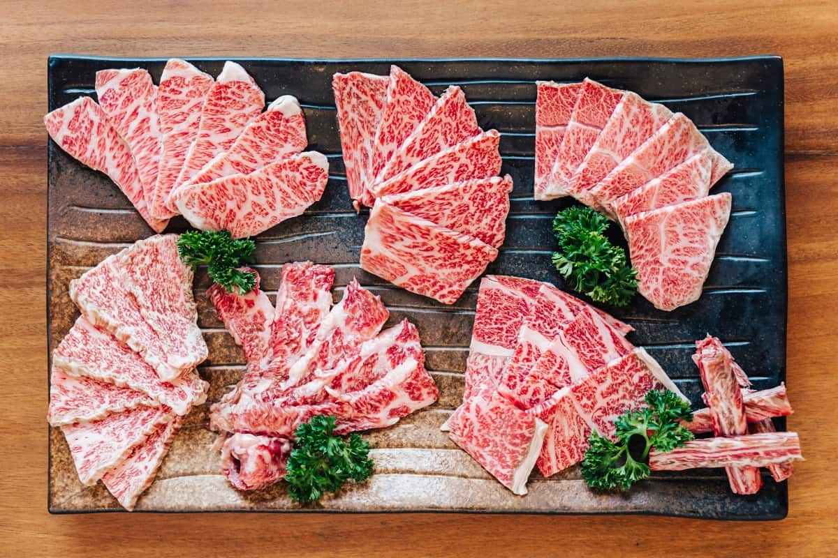 A selection of wagyu cuts spread out on a large cutting board