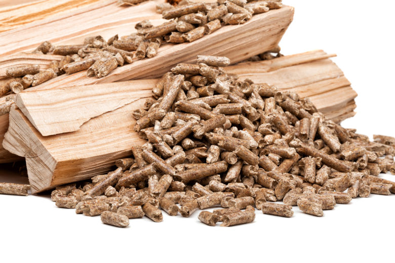 Wood chunks and pellets isolated on white