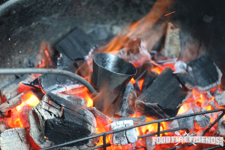 A flambadou heating in hot coals